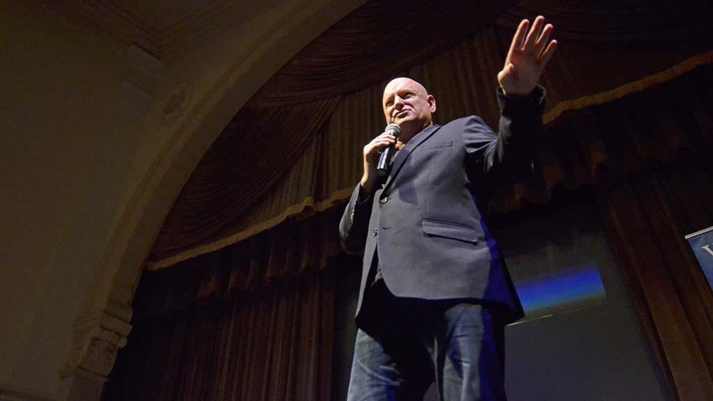 Retired astronaut Scott Kelly answers audience questions on a book tour stop