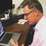 Rep. Scott Peters using Skype on a laptop