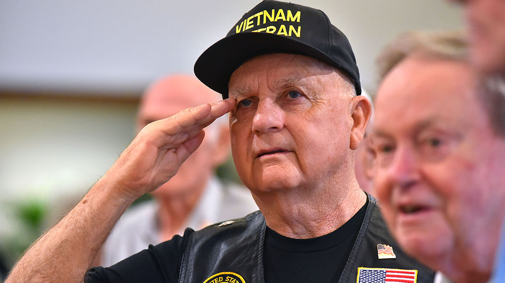 A Vietnam War veteran salutes during the National Anthem.