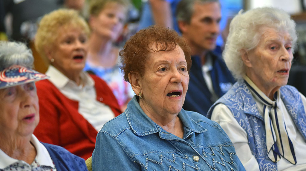 Veteran's wives and residents at Patrician participated in the singing.
