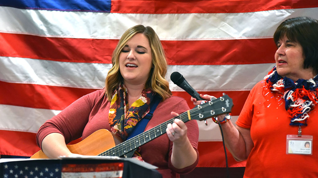 Christine Gallagher (left) and Denise Welsh lead a sing-along of patriotic songs.