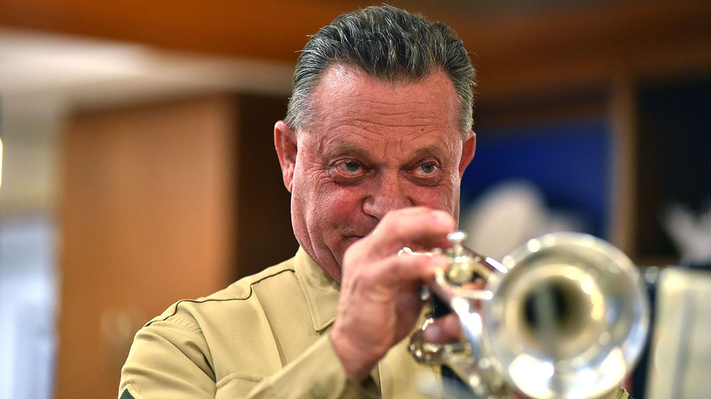 Roy Zanni of Buglers Across America played taps and hymn from the different branches of the military.
