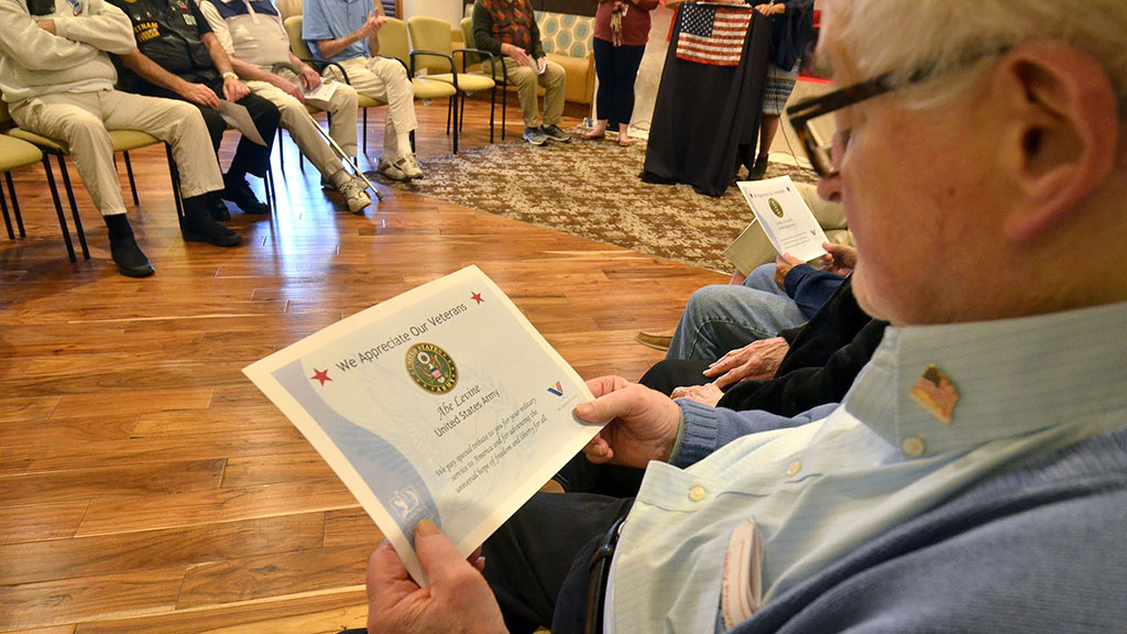Abe Levine received a certificate and pin for his military service.