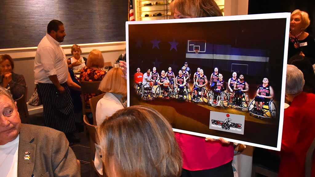 A veterans wheelchair basketball team is shown at the GOP women's club, which gave its sponsoring group a $2,000 donation.