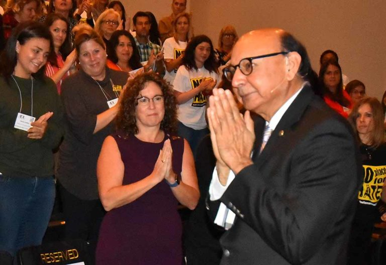 San Diego schools Superintendent Cindy Marten (in purple) echoes action by Khizr Khan.