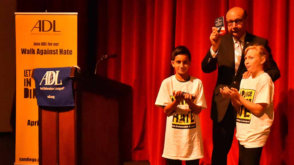 Khizr Khan displays U.S. Constitution he'll hand to local middle-schoolers.