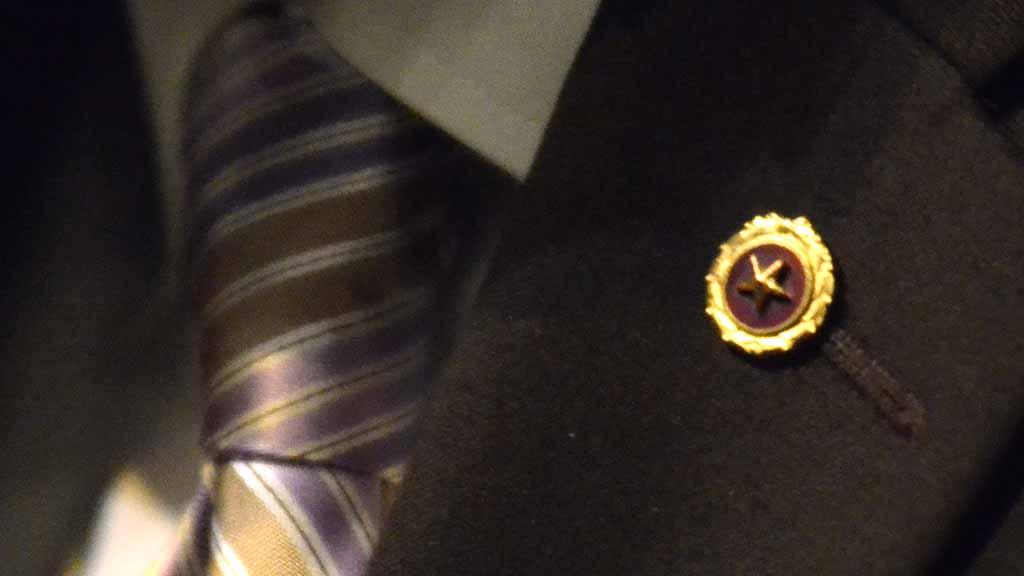 Khizr Khan wears a Gold Star pin, signifying being a parent of a fallen U.S. service member.