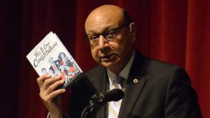 "Khizr Khan holds copy of his ""This Is Our Constitution,"" written for middle-schoolers."