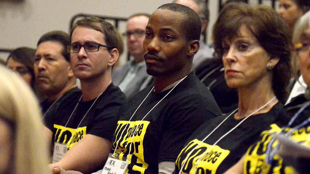 Mark Blackshear (center) listens intently to Khizr Khan at No Place for Hate Leadership Conference.