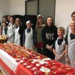 Volunteers prepare to serve dinner