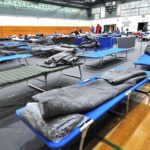 The Red Cross set up cots in the Oceanside High School gym for people displaced by the fire.