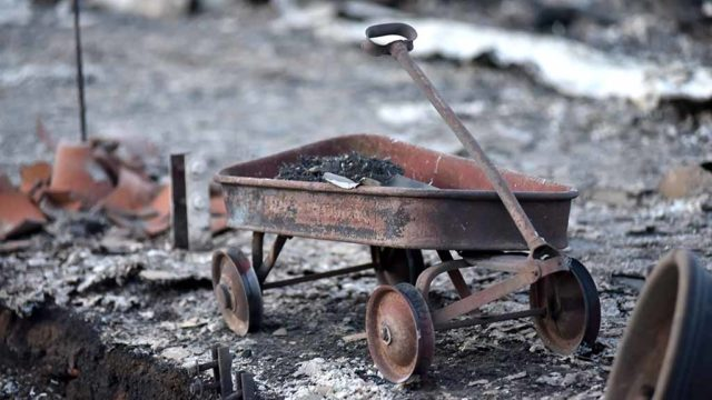 A little red wagon lost its rubbed wheels in the fire that swept through the Rancho Monserate Country Club.