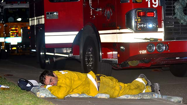 A San Miguel firefighter gets a well deserved rest after fighting the fire.