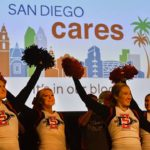 San Diego State University cheerleaders and band perform at the San Diego Cares Holiday Blood Drive.