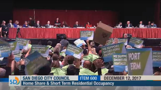 Supporters of short-term rentals wave placards