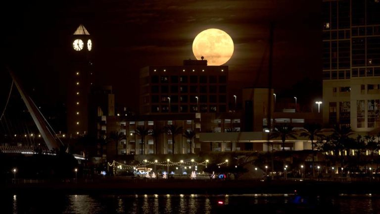 A supermoon rises above the downtown San Diego cityscape on Dec. 3, 2017.