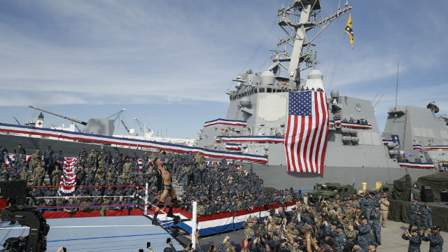 Wrestler with USS Dewey in the background