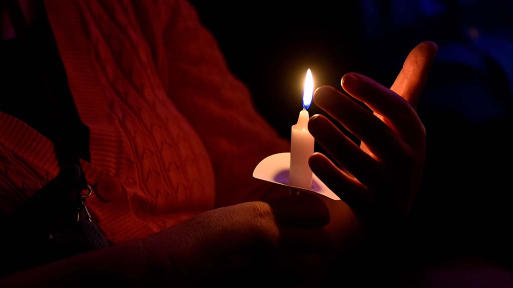 Prayers and songs were part of the candlelight ceremony on World AIDS Day.