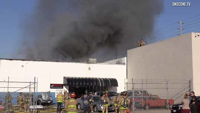 Thick smoke rises from fire near Lindbergh Field at Diko Auto Repair.