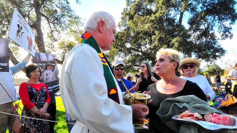 Ellen Ericksen, an animal rights activist, insists that the Rev. Michael Sinsor, bless bacon and bones