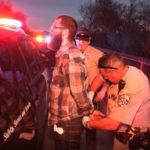 Suspect handcuffed