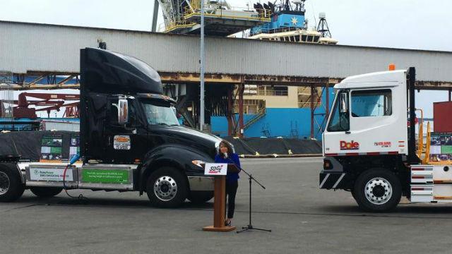 Caroline Winn with electric trucks