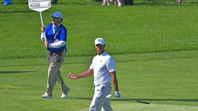 Tiger Woods responds to a spectator on Hole #5.