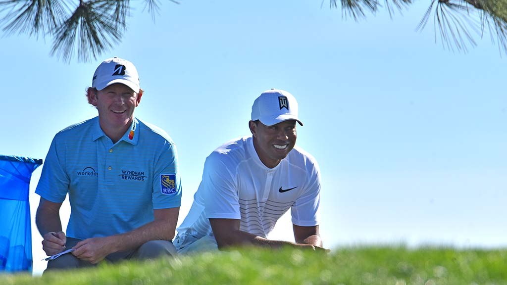 Brandt Snedeker and Tiger Woods get a brief time to relax before starting Hole #6.