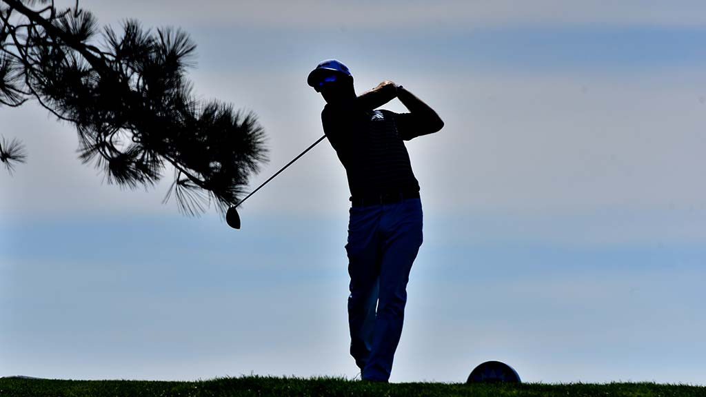 A PGA golfer tees off on Hole 6 of South Course at Torrey Pines.