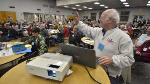 Club member Jeff Benesch waved to someone while handling audiovisual chores.