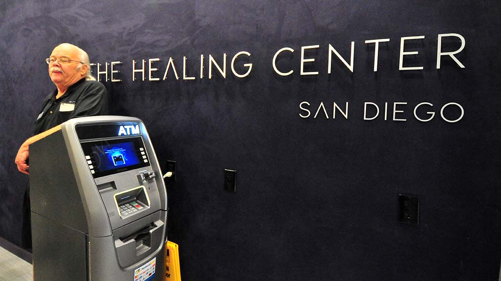 Ray Taylor, co-owner of the Healing Center San Diego, has an ATM machine for the cash purchases.