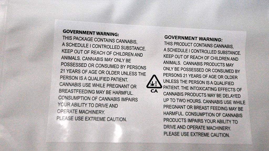 Generic white plastic bags with government warnings are given to customers at The Healing Center.