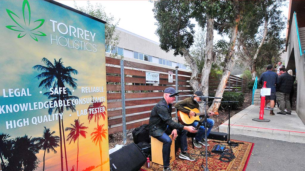 Jason Toney and Jeff Storm perform for waiting customers at Torrey Holistics in Sorrento Valley.