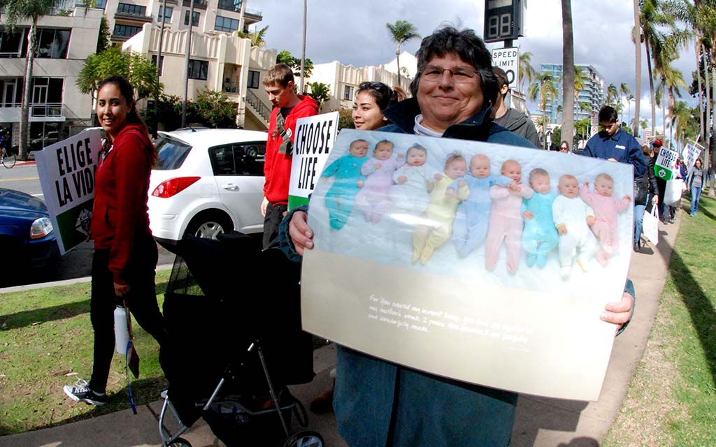 Baby pictures drew smiles along Walk for Life route.