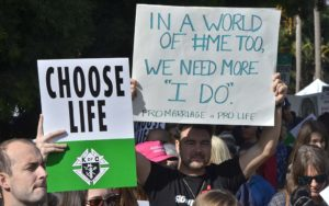 #MeToo movement was referenced in at least one homemade sign.