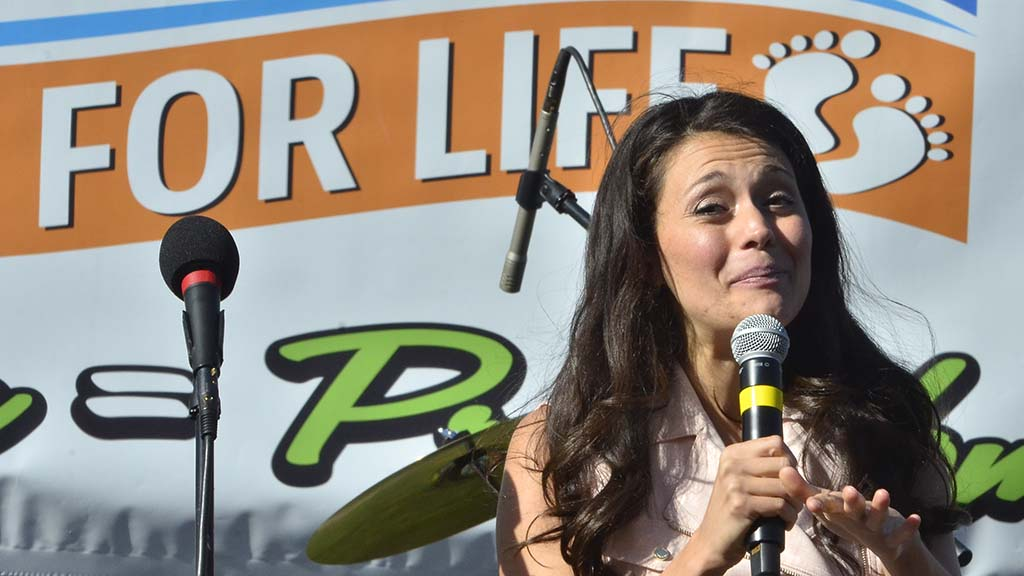 Christian radio personality Timmerie Millington emceed the event from a stage near Sixth and Laurel.