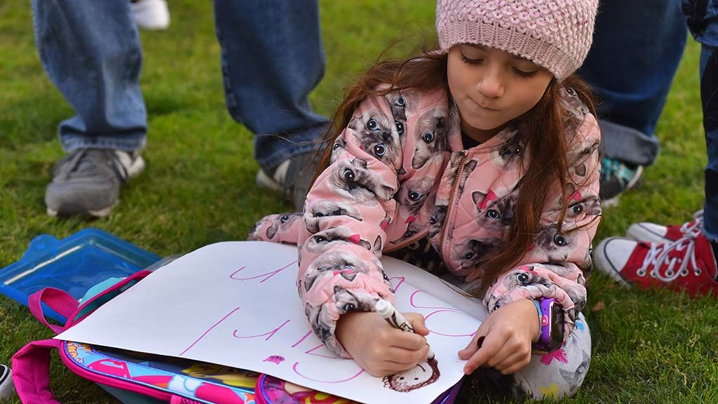 Elizabeth, 6, from Temecula readies a Girl Power sign for the march.