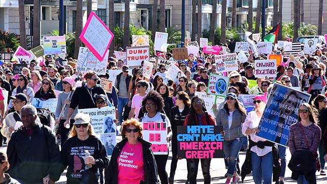 Tens of thousands of marchers crowded downtown San Diego streets for the second women's march.
