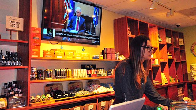 News about U.S. Atty. Gen. Jeff Sessions plays in the salesroom of Torrey Holistics in Sorrento Valley.