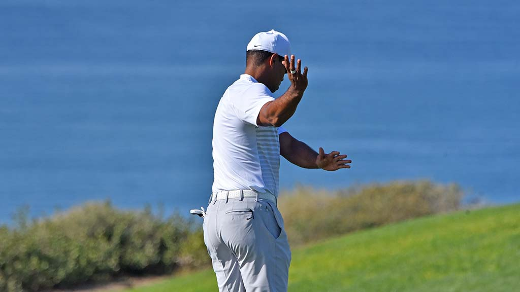 Tiger Woods practiced his swing as he walked down the fairway on Hole #4.