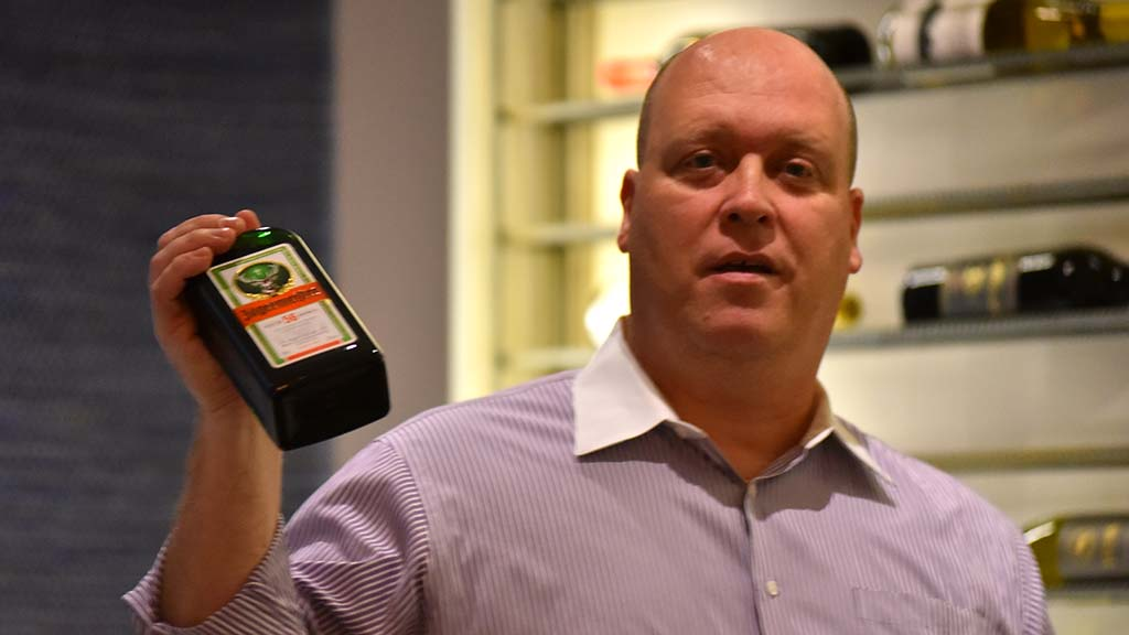 Tony Krvaric holds a bottle of Jagermeister liqueur — a thank-you gift from the GOP women's club.