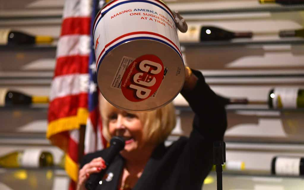 Navajo Canyon Republican Women Federated President Kat Culkin shows off suggestion box.