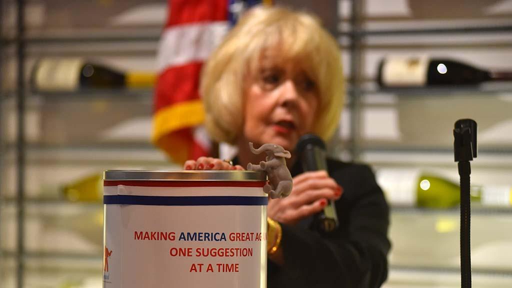 GOP women's club President Kat Culkins displays a new suggestion box.