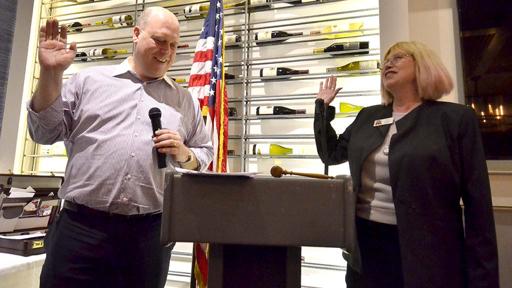 County GOP Chairman Tony Krvaric swears in Ginny Wisely to a club committee chairmanship.