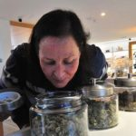 Angie Kitchen of La Mesa (left) and Heather Schene of Clairemont check the aroma of different flowers at Apothekare.