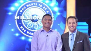 "San Diego's David Tamayo (left) with host host Chris Harrison of ""Who Wants To Be A Millionaire"" at summer 2017 taping in Las Vegas,"