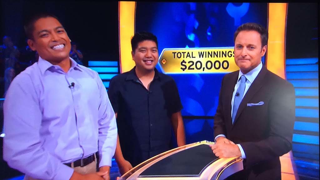 David Tamayo and cousin Ryan Tamayo are shown with host Chris Harrison and winnings: $20,000.