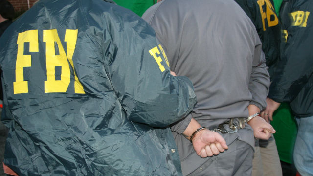 FBI agents arrest a man