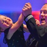 Navy Petty Officer Joe Kleefisch and his daughter Riley, 3, enjoy the YMCA Armed Services Father-Daughter Dance in Mission Valley.
