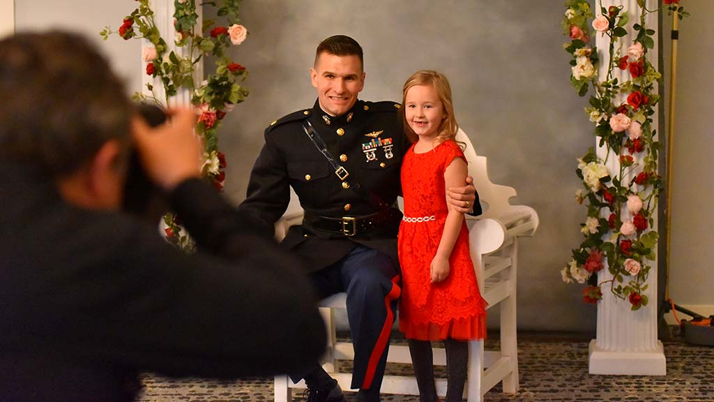 Marine Maj. Frank Machniak poses for a photo with his daughter, Lillian, 6.